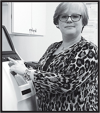 Dorothy Reynolds, L.O., takes charge of the finishing lab at Optical Alternatives in Fairfield, CT