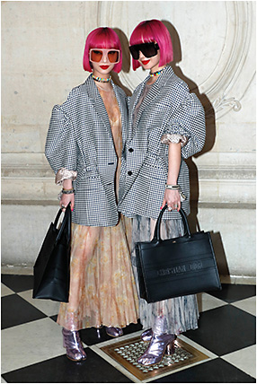 POSH IN PARIS: Ami and Aya Suzuki, the twin-sister duo behind pop music sensation Amiaya, rocked Dior's DiorSoLight1 sunglasses from Safilo while at Paris Fashion Week.
